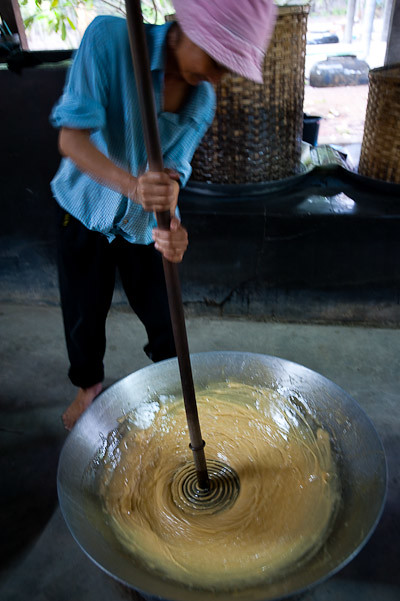 Whipping palm sap to make palm sugar, Samut Songkhram, Thailand