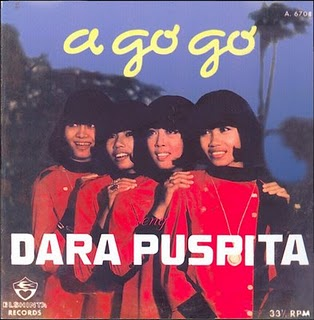 Dara Puspita, a foursome, have identifical sixties haircuts and wear bright red dresses against a dark blue Pacific sky. the album cover reads A Go Go in yellow