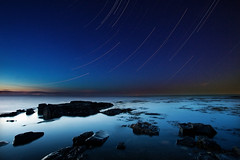 Look a the stars (Dan. D.) Tags: sea sky seascape water rock night canon stars landscape star long stack explore trail exposition frontpage stacked 1635mm 4min