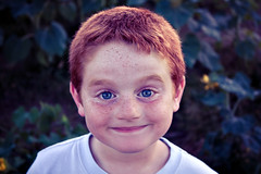 He stopped for a nanosecond (Jaime973) Tags: boy smile canon raw blueeyes redhead monthlyscavengerhunt msh msh0810 msh08102