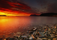 FIRE (~~~johnny~~~) Tags: sunset sky orange seascape mountains seaweed clouds landscape interesting rocks soft low wide smooth wideangle 09 lee artic grads hoya 075 firery nd8 leefilters articart johnnymyrenghenriksen