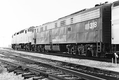 Amtrak's Champion led by SDP40F # 642, followed by PC E-8 # 318, will shortly be on it's way from SCL-Amtrak station to the railroad yard in Saint Petersburg, Florida, 1974 (alcomike43) Tags: old railroad blackandwhite bw station train vintage switch photo pc track diesel platform engine rail historic negative amtrak photograph depot locomotive siding acl 318 e8 scl dieselengine turnout passengertrain seaboardcoastline railroadyard emd diesellocomotive saintpetersburgflorida 642 penncentral dieselelectriclocomotive atlanticcoastline sdp40f amtrakchampion