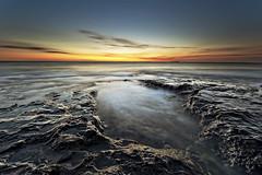 Smooth Pools (Reed Ingram Weir) Tags: longexposure light seascape sunrise coast 3d wide smooth explore northumberland pools april bamburgh volcanic frontpage 14mm singhray nikond700 reedingramweir riwp xprodiysizefilters