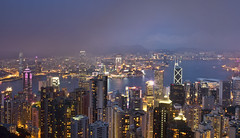 Forest of Lights (Jim Boud) Tags: ocean china travel panorama mountain seascape reflection water fog skyline architecture night clouds skyscraper canon buildings dark lens landscape asian island hongkong eos prime evening colorful asia downtown cityscape pacific cloudy dusk hill chinese foggy peak lookout fixed 24mm thepeak dslr digitalrebel kowloon photoart digitalslr f28 ef hongkongisland waterscape artisticphotography partlycloudy victoriaharbour victoriaharbor asiapacific jimboud t2i jamesboud eos550d kissx4