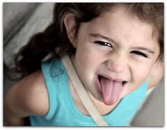 {Rhianna 365} day 364 - little miss. stubborn (citygirlny10305) Tags: blue cute girl tongue fun toddler funny child adorable naturallight shoulder picnik stubborn catchlight stickingout 365project canon5dmarkii