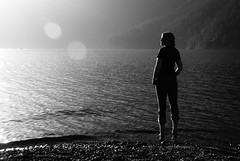 the rocks were sharp on my tender feet, the sun was warm in my tender heart (lydiafairy) Tags: sunset lakecrescent blackandwhite bw sun lake selfportrait love me nature water silhouette evening lensflare wade olympicnationalpark wadinginthecoolwater