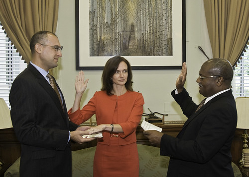 Dr. Elisabeth Hagen is sworn in to her new position as Under Secretary for Food Safety. Pearlie S. Reed, Assistant Secretary for Administration, swears her in as her husband, Dr. Daniel Gabbay, holds the Bible.