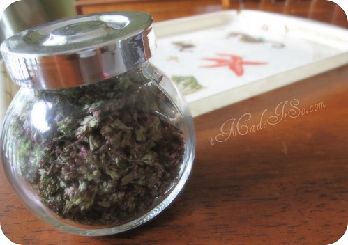 dried oregano flowers in an air tight jar