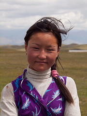 Jailoo girl (Evgeni Zotov) Tags: asia kirgizia kirghizia   kyrgyzstan kirguistan kirghizistan kirgisistan kirgizi kirgistan kirgizistan quirguisto krgzistan        alay  sarymoghul sarymogol  people kyrgyz girl shepherd jailoo pasture portrait smile wind highland blue