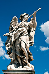 Angel statue at Ponte Sant'Angelo (LimeWave Photo) Tags: city travel italien bridge blue sky italy rome roma statue angel movie italia capital ponte rom lazio rm angelsanddemons pontesantangelo romanbridges aelius aelian limewave