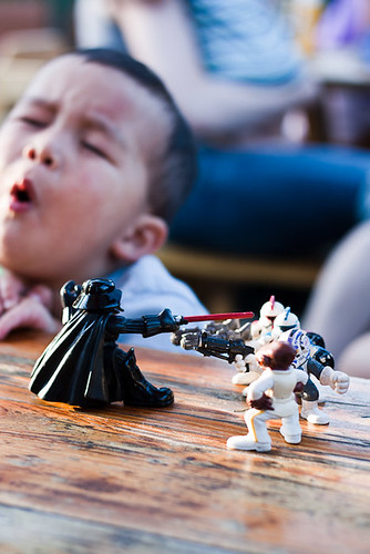A child whines while Darth Vader defends the empire