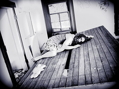 Life is cold here, empty hallowed ground. (bellydnce1103) Tags: blackandwhite house selfportrait abandoned girl project illinois 365 rockford laying bluetint viginette
