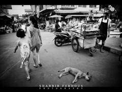 Mae-Klong Station Road (Shabbir Ferdous) Tags: light people blackandwhite bw thailand photographer shot bangkok ef2470mmf28lusm bangladeshi mahachai shabbirferdous mahachaitrainstation samuthsakornprovince maeklongstationroad wwwshabbirferdouscom shabbirferdouscom