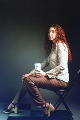 Tanya Color Portrait 6 (neohypofilms) Tags: lighting red portrait woman color slr classic film cup coffee girl beauty fashion shirt female 35mm vintage pose painting hair studio fun 50mm nikon shoes pants legs sandals ad style retro curly slacks clogs curl placement seated platforms coluor