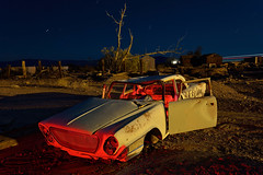 the all-new newport for 1962. ludlow, ca. 2014. (eyetwist) Tags: eyetwistkevinballuff eyetwist abandoned california mojavedesert dark night longexposure fullmoon moonlight mojave darkness desert nikon nikond7000 d7000 nikkor capturenx2 1024mmf3545g photography gel tripod npy nocturne highdesert weathered rusty america americana americantypology landscape startrails star trails junkyard cars wrecks lineup dented sodiumvapor sodium vapor junk security car auto rust long exposure ludlow route66 route 66 mother road 1962 chrysler newport grille freight train bnsf transcon westbound wreck ruin tree red yellow american west
