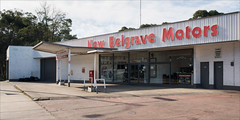 belgrave-8355-ps-w (pw-pix) Tags: garage servicestation petrolstation service fuel sales parts accessories formerbusdepot formerusbusdepot workshop brick painted white red grey showroom pipes canopy awning forecourt apron concrete steel footpath trees sky clouds newbelgravemotors c412 c404 monbulkroad belgrave thedandenongs outersuburbs outereast urbanfringe melbourne victoria australia