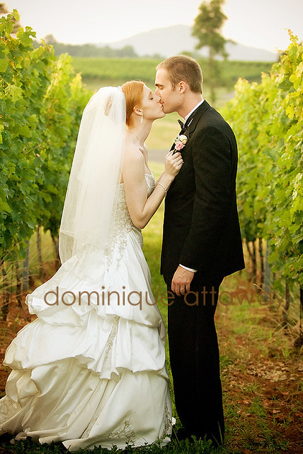couple kissing in vines