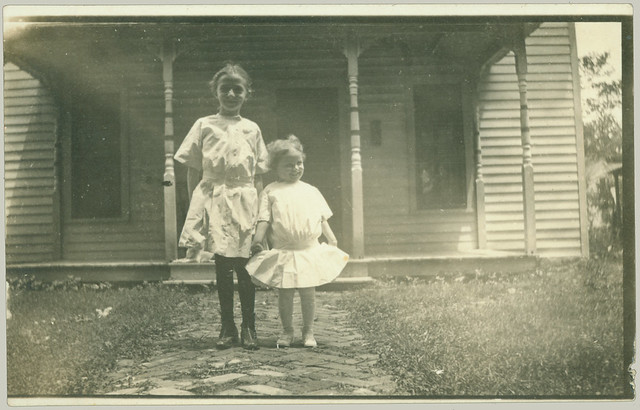 Two girls on the front walk