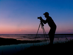 The keen photographer (sujiform) Tags: sunset sun night river photo photographer