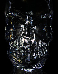 Terminator (Jason A. Samfield) Tags: light white black macro glass face contrast dark death skull scary shiny crystal evil illuminated led plastic clear reflect human wicked reflective terminator dim glassy humanlike crystalskull ledlight whiteled whiteledlight
