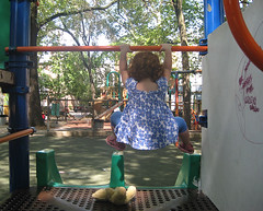 Speck performs the obligatory bar-hang before going down a slide; Tsah lies waiting her turn