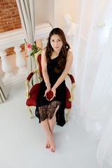 Japanese woman wearing black dress sitting in ...