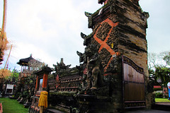 Large Temple Entrance (cwgoodroe) Tags: light summer sky bali detail statue temple buddha pray limestone hindu pura deity ubud diety batubulan