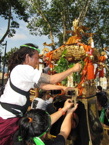 A team effort to decorate the Omikoshi, Powell Street Festival 2010 where Japanese tradition meets new expression in Vancouver Canada