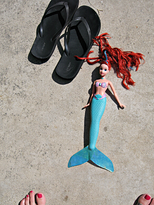 the little mermaid doll and flip flops