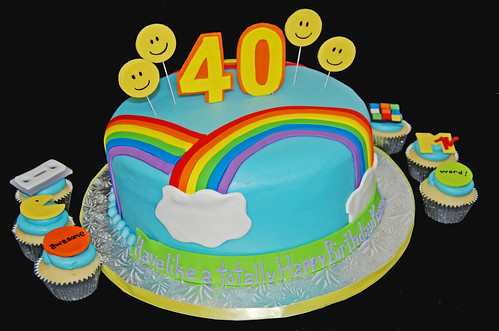80s themed 40th birthday cake and cupcakes