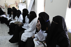 Women attend a class in midwifery at the Health Service Institute
