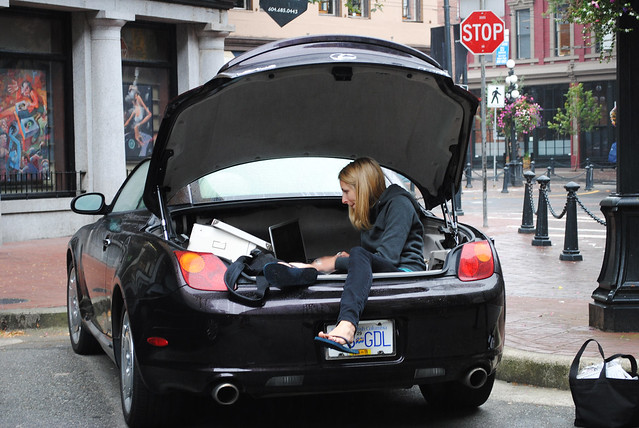Andrea editing photos in the trunk haha