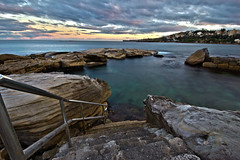 Step by Step into Bliss (Sam Lodge) Tags: ocean longexposure light sunset sea cloud storm colour beach water pool beauty sunrise canon photography bay photo movement rocks long flickr sam angle wide sydney australia wideangle lodge explore 1020mm 1020 clovelly hdr coogee teenage gordons gordonsbay 10mm 550d teenagephotographer samlodge samlodgephotography