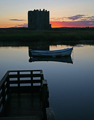 Threave Castle sunset (steverichard) Tags: sunset red sky castle water beauty silhouette night canon dark eos evening scotland boat alba fort jetty ken scottish peaceful serenity 5d serene moat galloway gloaming settingsun ecosse threave castledouglas threavecastle stewartry steverichard