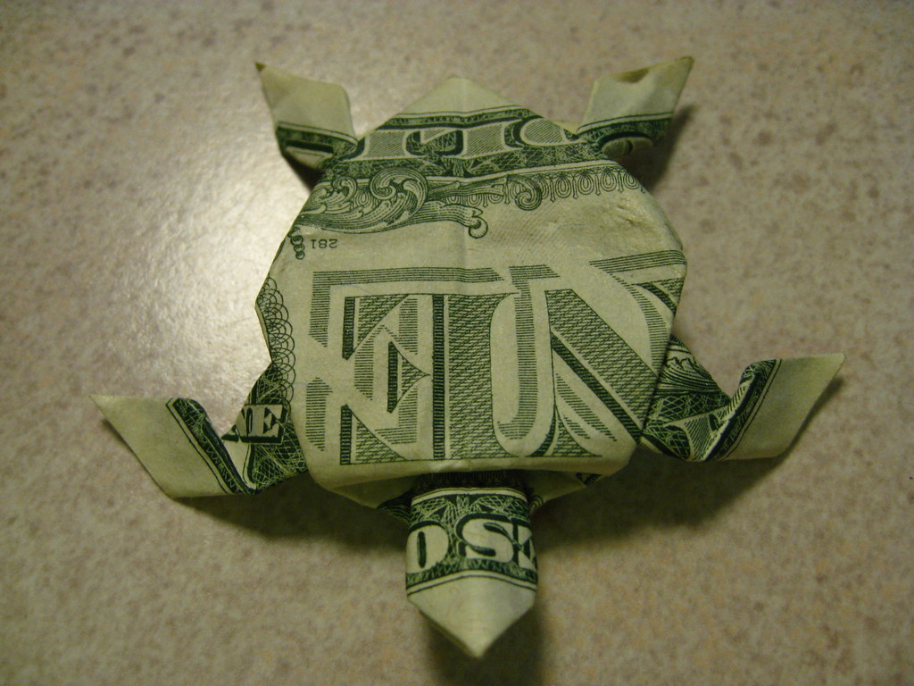 Origami sea turtle dollar bill