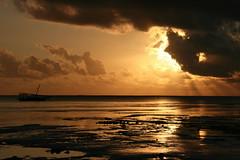 untitled (Blue Spirit - heart took control) Tags: sun clouds sunrise reflections boat barca nuvole alba zanzibar sole riflessi nungwi bestcapturesaoi