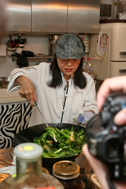Margaret stir-frying the ingredients in hot oil