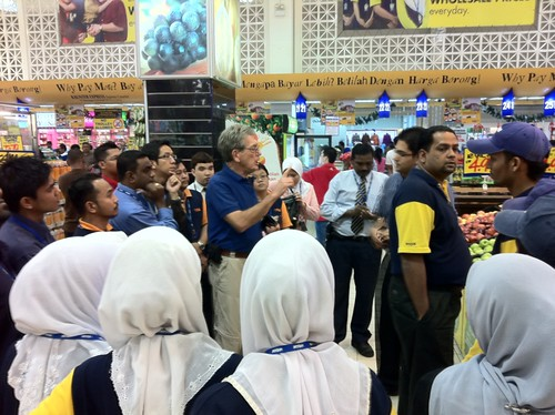 Participants visited a local supermarket to view marketing displays and how to better promote U.S. produce.