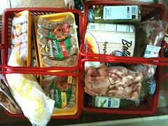 Shopping basket of chicken, sausages, cheese, cream, mascarpone, bacon, herbs, spaghetti sauce