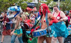 Drummers and a Fish (UrbanphotoZ) Tags: mermaidparade coneyislandmermaidparade women marchers drummers fishhead pasties fishnet snare redwig mardigrasbeads corncobpipe spectators coneyisland brooklyn newyorkcity newyork nyc ny
