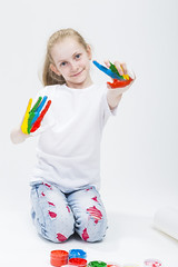 Kids Concepts. Portrait of Smiling Young Girl Showing Messy Colorful Hands Brightly Painted During Paint Craft. Against White Background. Focus on Hands (DmitryMorgan) Tags: 1 711years active againstwhite artist artistic arty caucasian cheerful child childhood color colorful colour concept craft creative creativity daughter drawing education female fingers fun gouache hand happy kid little messy multicolor one paint painter palms people playful pleasure positive preschooler smiling tshirt young