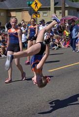 Street Gymnastics (swong95765) Tags: kid girl gymnastic flip talent skill holiday parade stunt midair