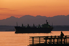 Silhouetted fisherman with tanker in Puget Sound (Jim Corwin's PhotoStream) Tags: seattle travel sunset vacation inspiration tourism nature water beautiful beauty horizontal relax landscape outdoors photography one freedom pier countryside fishing fisherman commerce waterfront sightseeing relaxing scenic peaceful icon tourists pacificnorthwest destination pugetsound leisure recreation inspire trade iconic idyllic tranquil carefree landforms naturalworld mothernature inspiring fishingpier imports exports olympicmountains restandrelaxation dramaticsunset locallandmark beautyinnature leisureactivity localattractions famouslocation silhouettedpier