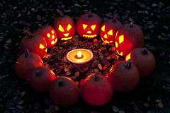 Carved pumpkins with pumpkin pie (Jim Corwin's PhotoStream) Tags: autumn decorations sunset fallleaves plants holiday fall halloween face vegetables childhood festival horizontal night circle season pie pumpkin fun outdoors happy photography evening carved scary twilight backyard october candles sitting candle seasons faces dusk jackolantern trickortreat treats pumpkins group humor harvest dramatic excited eerie illuminated autumnleaves haunted carve neighborhood celebration nighttime pumpkinpie trick tradition funnyfaces excitement decorate playful secular 31st pagan customs anthropomorphic seance witchinghour largegroup fallseason residentialneighborhood lightedpumpkins lightedcandles pumpkinseance