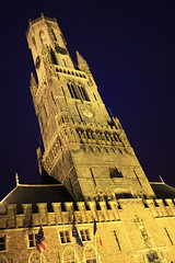 Bruges - Belgium - Belfort (tom.wright) Tags: blue light building tower clock yellow vertical night evening europe dynamic belgium dusk flag gothic brugge illumination belgi illuminated diagonal belfry bruges belfort illuminate labelgique canonefs1022mmf3545usm tomwright copyright2010