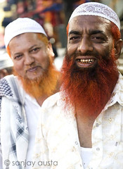 Henna dyed bearded men at Charminar, Hyderabad, India (sanjayausta) Tags: street old city portrait india men smile photography asia photographer indian south muslim documentary beards photographs henna hyderabad andhra dyed sanjay pradesh urdu austa hyderabadi