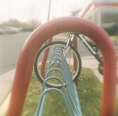 loop loop loop loop (cavale) Tags: camera blue red 120 film nova grass bike bicycle square virginia blurry lomo fuzzy outdoor rack brownie dreamy parked portfolio herndon reston reversedlens browniehawkeye silverdiner cavalephotonet