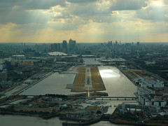 Surrounded by water (Frans Zwart) Tags: city london water thames airport warf dusk airplanes docklands canary approach 27 runway flightdeck embraer egll lcy