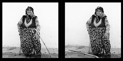 "Woman With Cane in Izmir, Turkey (Sailing ""Footprints: Real to Reel"" (Ronn ashore)) Tags: life street old people blackandwhite bw woman 6x6 film portraits mediumformat turkey square diptych faces muslim islam headscarf hijab ilfordhp5 elderly age customs f35 75mm kodakhc110 whitekodak rolleiflexf35 june2010 planarilford zeiss75mmf35planar izmirturkeyrolleiflex f35zeiss hp5filmbwblack hc110womanelderlyageoldstreetportraitsfacespeoplelifecustomsislammuslimhead scarfjune 2010medium format6x6squarediptych hp5f"