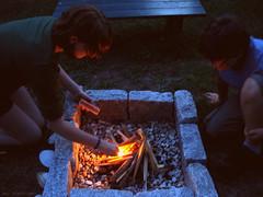 making fire (On Bradstreet) Tags: fire firepit summerevenings unschooling familyrituals outdoorskills keepingitsimple eveningsathome backyardfirepit simplefirepit kidsbuildingfire